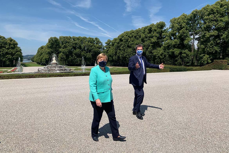 Angela Merkel und Markus Söder am Schloß Herrenchiemsee